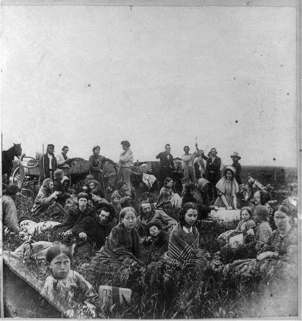 1862. People escaping from the Indian massacre of 1862 in Minnesota, at dinner on a prairie. (Adrian John Ebell, Library of Congress)