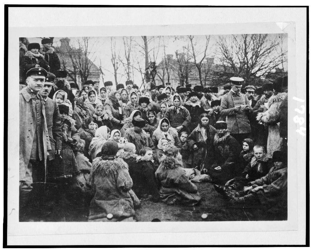 ca. 1912. [Crowd of refugees(?)--, possibly Jewish, and three officials outdoors, Russia] (Library of Congress)