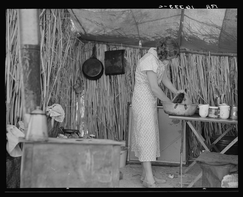 1937. Drought refugee living in a ditch bank camp. Imperial County, California. (Dorothea Lange, Library of Congress)