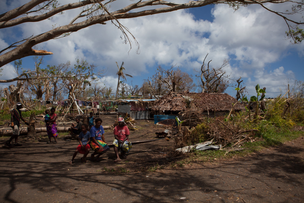 Local residents of the village of Lumbukuti are still awaiting substantive aid. The once-lush, shady village was largely destroyed by Cyclone Pam in 2015.