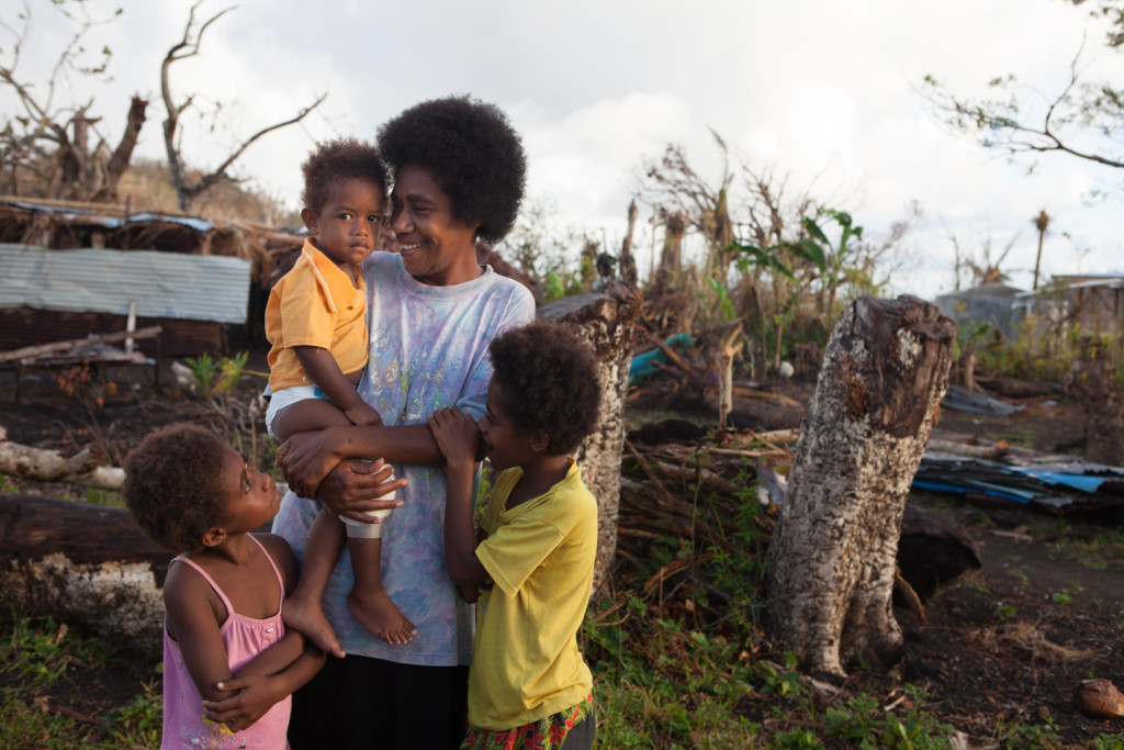 Rinnie David pictured with her son, Abed, 2, and twins Elizabeth and Annon, aged 9. The village where they live, Lumbukuti, was mostly destroyed by Cyclone Pam.