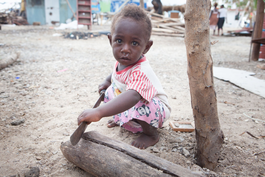 Kalos Hendry, 1, has some fun playing with a machete. The Hendry's house was totally destroyed by Cyclone Pam. Seven houses in Takara, including theirs, were hit by the violent waves of the storm surge.