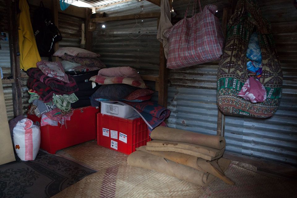 The inside of the Hendry family home. Since the cyclone, seven people sleep in this room: Kals Hendry, 43, his wife Marie Hendry, 39, and their five children, Amos, 14; Lina, 11; Fanny, 9; Maturine, 4; and Kalos, 1.