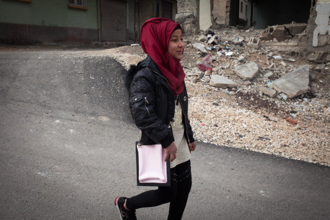 On her way to work, Fatima is only 12 years old and earns 45 cents per hour.
