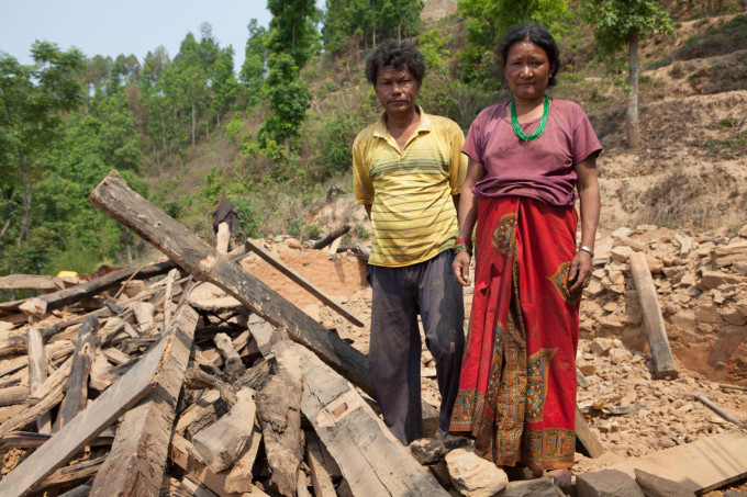 Dhatur and Sirin Tamang live with their children and relatives in compound of 12 houses. One building remains livable.